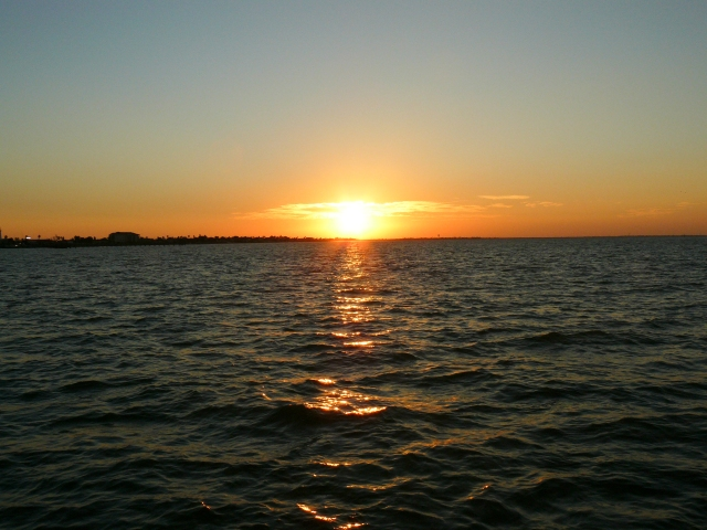 The sunset and the Gulf of Mexico off South Padre Island while on a boat
